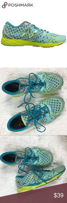 """New Balance 1400V2 Running Shoe in Blue / Yellow New Balance 1400V2 Running Shoe in Blue / Yellow. Women's size 8.5. Some wear on sole, detail loose / detached in places under toe as pictured. Less than 100 miles on shoes!  """"Features Synthetic Imported Synthetic sole Weight: 5.7 oz (161g) 10mm hell-to-toe drop No-sew welded seams Tongue tab doubles as pin loop to stash pins for a racing bib Light and responsive, this racing flat features a REVlite midsole to help you push your performance.""""…"""