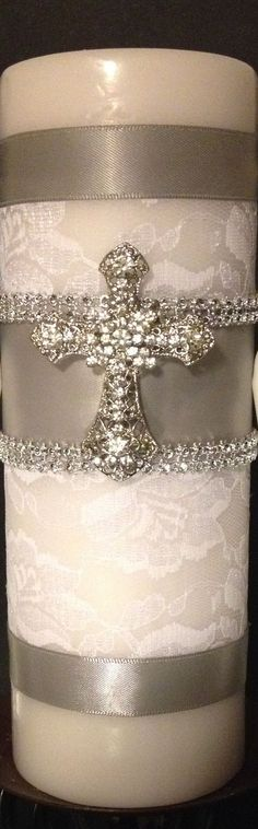 Baptism or Christening Candle. Covered w/ white lace. Silver ribbon and silver sccents. Beautiful cross pendant in its center. Baptism Candle, Baptism Favors, Baptism Ideas, Baptism Party, Baby Christening, Baptism Decorations, Baby Dedication, First Holy Communion, Candle Jars