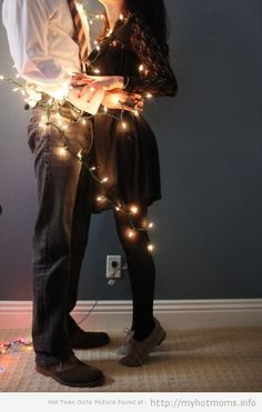 Cute idea for a new couples' Christmas card. It would be even cuter with a tree, half lit, in the background.