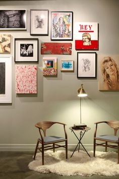 Gallery wall- love the mix of frames and canvases.
