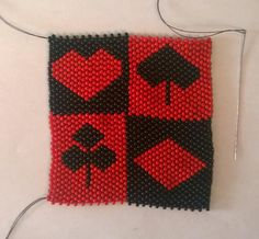 Hand sewn peyote stitch beaded lighter cover. Made with 10/0 size seed beads. Fits over a regular sized Bic lighter. Bottom is sewn tighter to close in a bit so the lighter does not fall through. This is an original design of my own. Harley Quinn style image in black and red with card suit symbols inside blocks of alternating red and black colours.
