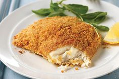Fish fillets with a coconut-pecan coating are baked until just done and served with a delightful pineapple-mango salsa.
