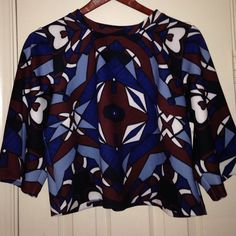 Eloquii crop mock neck top size 18 Eloquii crop  style 3/4 sleeve top ... Worn 1 x excellent condition brown blue black with off white accents!!!  Perfect paired with a high waisted skirt or jeggings!! Eloquii Tops Crop Tops