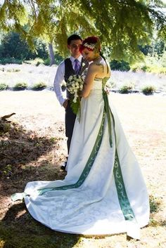 My dress was $90 off craigslist. I made the headband myself.  The picture is a replica of one from my parents' wedding.