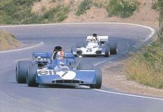 Francois Cevert, Tyrrell-Ford, #7 (finished 4th) leading Mike Hailwood, Surtees-Ford, #26 (finished 6th) French GP, held at Charade Circuit in Clermont-Ferrand, Auvergne, France on July 2, 1972.