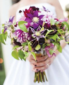 Brides Magazine: How Much Do Wedding Bouquets Cost? Bouquet of clematis, dahlias, scabiosa, and hellebore    $200, by Petalena, Boston