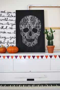 Grab your string, paint and nails, because you need this skull string art in your home during the Halloween season.