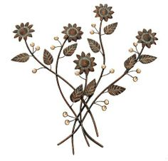 Metal wall décor; Wall décor; Small sunflower design; Glass being on the wines. Metal wall art with a bit of ...