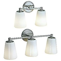 Centric Bath Bar by Norwell    3-Light Option: Height 9.5 In., Width 23 In., Depth 6 In.  Wall Plate: Diameter 4.9 In.