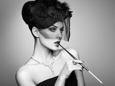 Portrait of beautiful sensual woman with elegant hairstyle - Portrait of beautiful sensual woman with elegant hairstyle.  Woman with cigarette Perfect makeup. Fashion photo. Black and white