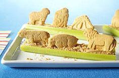 To the grown-up eye, this is just animal crackers propped on peanut butter in celery stalks. To kids, it's something else altogether!