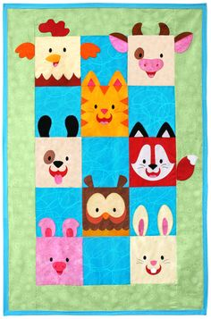 """Barnyard Buddies quilt pattern measures 31 1/2"""" by 49"""". Can be expanded to 63 1/2"""" by 78"""" by adding additional borders. Instructions for both sizes are included. What a bunch of happy critters!"""