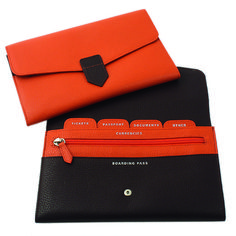 Leather document wallet with interior indexed slots, passport, ticket and other document compartments and zipped internal coin pocket. Fabriano boutique