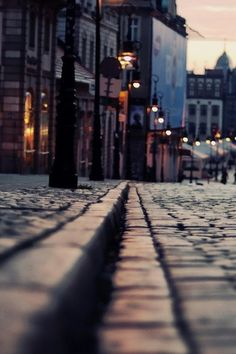 Sunset-lit cobblestones and streetlamps