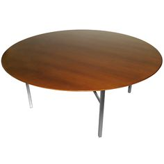Knoll - Huge 6 foot Round Walnut Table with Iron Legs | From a unique collection of antique and modern dining room tables at https://www.1stdibs.com/furniture/tables/dining-room-tables/