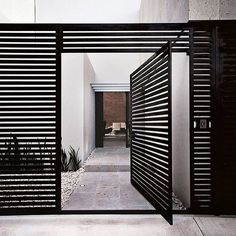 This door is amazing Via insideoutmag architect- home, entrance, design