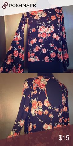 Glamorous Floral Blouse. Glamorous floral blouse with opening in the back and bell sleeves. one clothing Tops Blouses