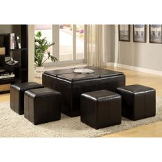 With a combination of function and timeless style, this black leather storage ottoman with tray features four nesting stools and four reversible trays. This makes it ideal as a cocktail table or additional seating area in your living room. Outdoor Furniture Sets, Furniture, Table, Ottoman Set, Home Decor, Leather Coffee Table, Furniture Of America, Coffee Table, Storage Ottoman