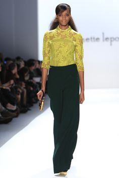 Chartreuse lace top, forest green pants, gold wristlet.