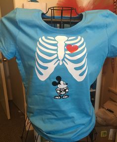 A personal favorite from my Etsy shop https://www.etsy.com/listing/460705822/mickey-inspired-maternity-shirt-xray
