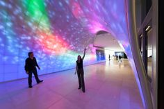 """media lighting system installation named """"Aurora"""" by Electroland was realized using advanced parametric design, digital fabrication, and 47,000 RGB LED pixels from Philips Color Kinetics at the DirectTV headquarters in El Segundo, California."""