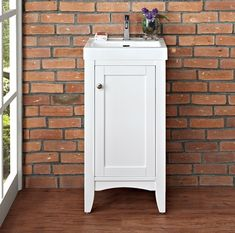 """Shaker Americana Vanity in Polar White  17.5x 15.5 x 33.5  (w/ sink shown overall height is probably 36.5 and w/ 1.25"""" counter it would be 34.75h)"""