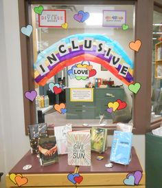 YA Pride Month Display celebrating positive representations of LGBTQ YA characters. Book list included in post.
