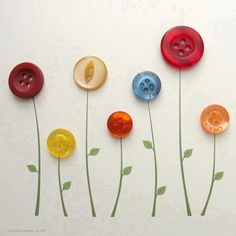 Add a darling border to your child's room.  Simple painted stems and leaves and glue a button on for the flower.
