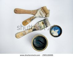 Brushes and blue can - stock photo