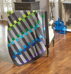 Contemporary quilt patterns tend to make traditional quilt arrangements pop! Traditional quilters can& resist the bold, bright colors in this quilt. This throw size quilt pattern appeals to modern and contemporary quilters, with its bold colors using pre- Jellyroll Quilts, Lap Quilts, Strip Quilts, Patchwork Quilting, Longarm Quilting, Cotton Quilts, Machine Quilting, Modern Quilting Designs, Modern Quilt Patterns