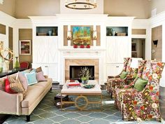 pattern livens up this space.  love the jill rosenwald rug and skirted wing back chairs.