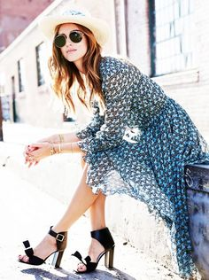 Chiara Ferragni of The Blonde Salad wears a printed chiffon dress with ankle-strap heels, retro sunglasses, and a straw hat