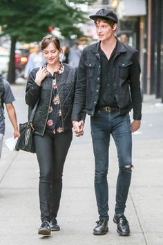 The quintessential NYC couple, Dakota Johnson and Matthew Hitt in black, of course. http://thestir.cafemom.com/beauty_style/189274/dakota_johnsons_street_style_in