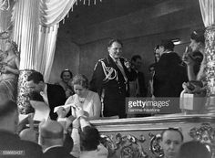 Joseph Goebbels and Emmy Goering signing autographs with Hermann Goering at the Royal Opera House in Berlin.