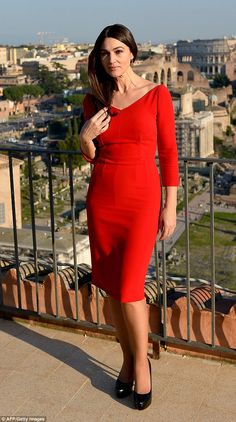 Stunning star: Actress Monica wowed in a scarlet dress, showing off her svelte shape...