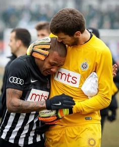 Partizan Belgrade goalkeeper comforts his teammate after he is barraged by racist chants for 90 minutes