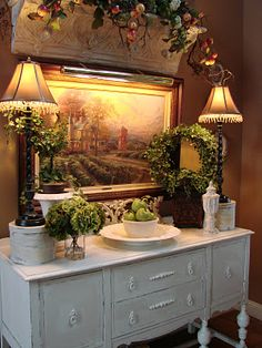 Gorgeous! A lovely mix of French and rustic country decor :) I would switch out the painting for a mirror, but either way, it's beautiful!