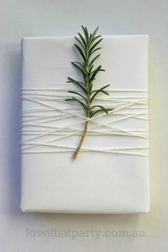 white christmas gift wrap rosemary sprig. simple and beautiful