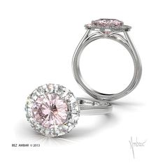 A fancy pink diamond engagement ring featuring a 1.00 carat round center diamond with a frame of Blaze® cut diamonds and a bare shank in 18k white gold.