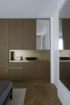 Brass inset & trim on wood cabinets, Tristan Auer's Parisian home
