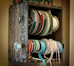 Old wooden crate turned into storage for spools of ribbon etc....vintage/shabby chic