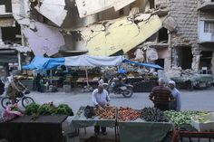 "Top News: ""SYRIA: Islamic State Militants Battle Rival Insurgent Groups North Of City Of Aleppo"" - http://www.politicoscope.com/wp-content/uploads/2015/10/Civilians-shop-for-vegetables-and-fruits-displayed-in-front-of-a-damaged-building-in-Aleppos-Bustan-al-Qasr-neighborhood-Syria.jpg - ""There are fierce battles between us and Daesh in Ahras, Tel Jabin, and rural northern Aleppo,"" said Hassan Haj Ali, head of Liwa Suqour al-Jabal rebel group.  on Politicoscope - http://www.po"