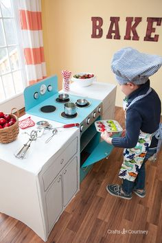 Your little chef will have lots of fun in the kitchen creating play meals with this cool cardboard box craft stove. The best part we were able to make this retro style stove with just one large cardboard box, knobs that turn, and a baking rack on the inside