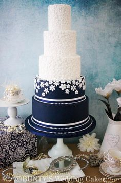 Navy Fabric Flower by Bunty's Wedding Cakes - http://cakesdecor.com/cakes/259607-navy-fabric-flower