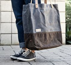 Supply Tote by SeaVees: Made of premium waxed canvas with a dark brown double bottom layer, cowhide straps and copper rivets. $200 #Tote #SeaVees