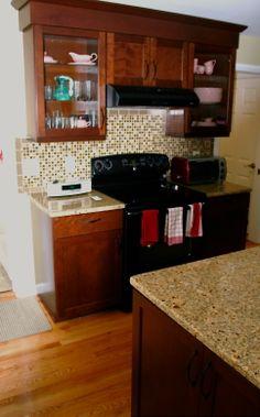 Waypoint Cabinetry in Cherry, granite countertop and glass mosaic backsplash make this kitchen a wow. #RhodeIslandKitchen
