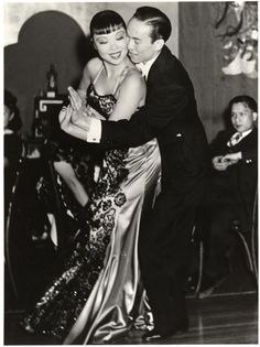 These two Asian American dancers are performing at San Francisco's premiere nightclub in the 1930s called Forbidden City. While the club was Chinese-themed, the performers themselves were not all Chinese American. Some were Japanese American and Filipino American.  Less than a decade after this photo was taken, all of the Japanese American performers would be interned under Executive Order 9066.   Source:Museum of Performance and Design, Performing Arts Library, University of California