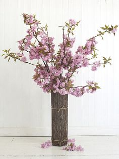 Feminine Cherry Blossom Flowers Arrangement Idea Put Inside Rustic Log Vase With Mini Rope Surrounding The Vase living room, festive idea