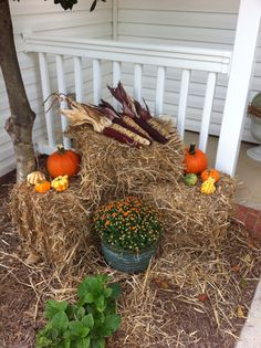 I like the idea of some straw on the ground and the corn husks on top of the hay stack.