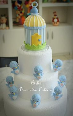 Little blue ducks and a blue bird cage for this multi tiered cake.